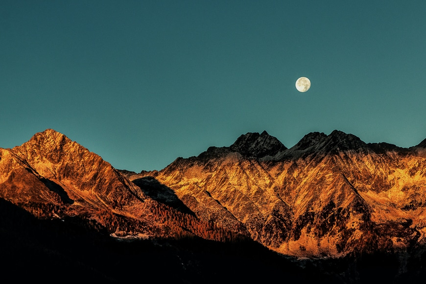 Full moon above mountains