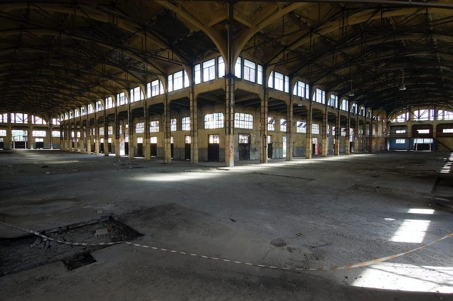 Interior of old warehouse space with arched ceiling