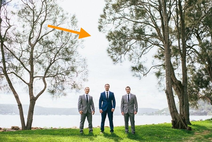 groomsmen under trees