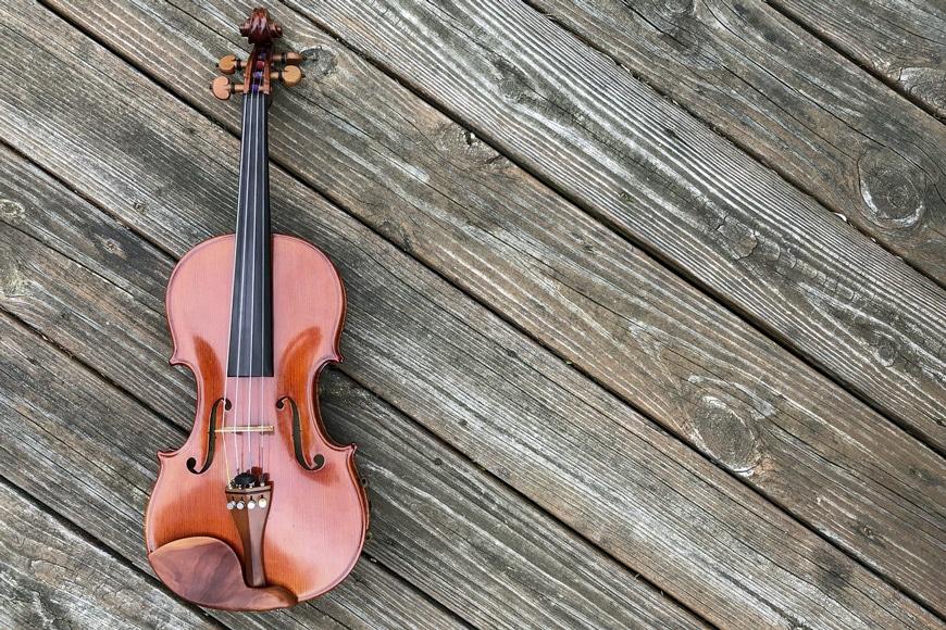 Violin lying on wooden floorboards