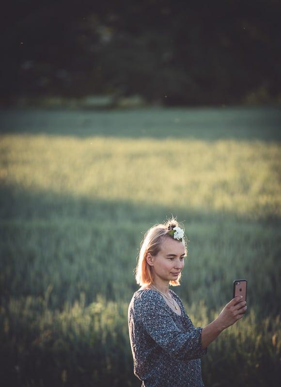 Girl in field taking selfie