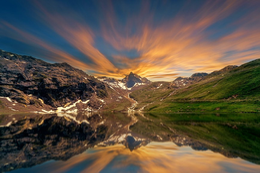 Landscape image of mountains reflected in lake