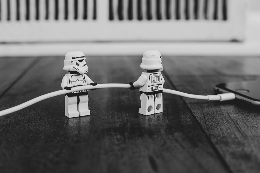 Stormtrooper figurines plugging in an iphone