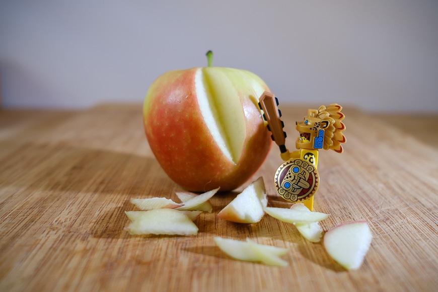 Aztek figure chopping up an apple