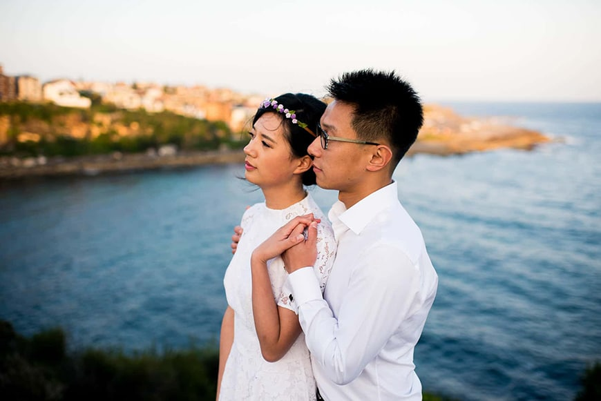 Couple looking to the horizon as a romantic engagement shoot pose