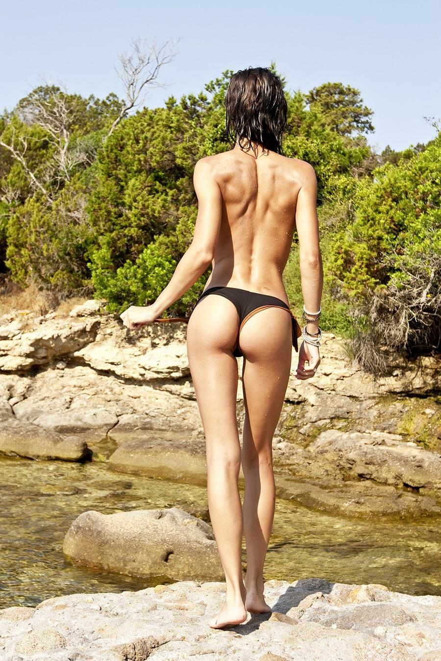 Model in brazilian bikini bottom