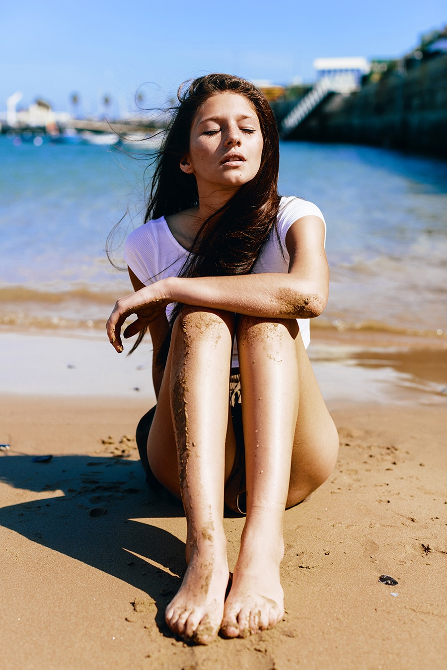 Photo of a model sitting at the beach
