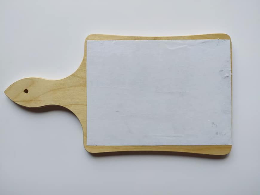 Photo glued to wooden object
