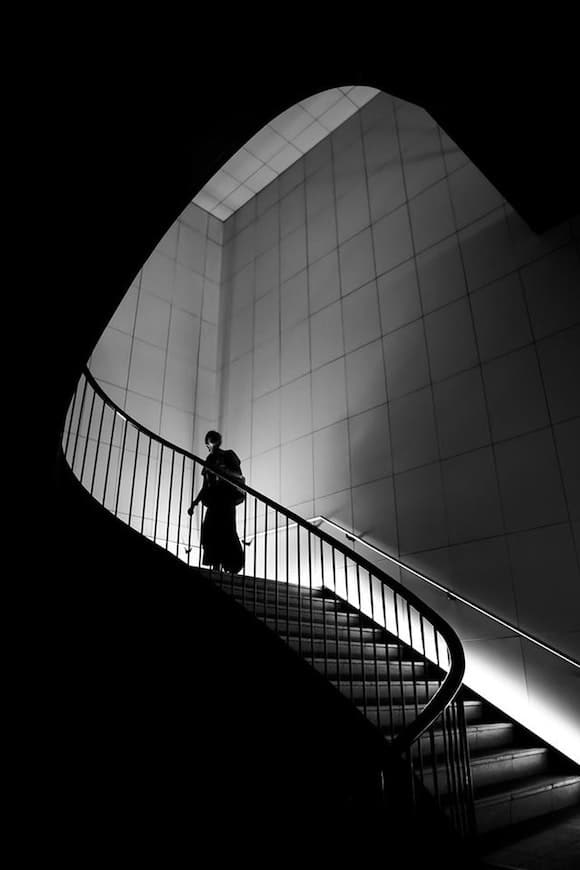 Person silhouetted against a staircase