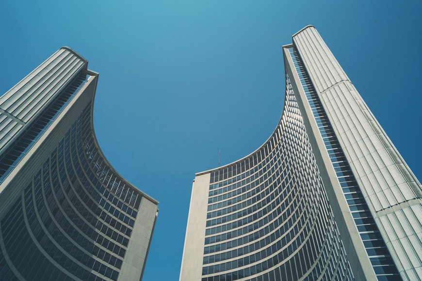 Two curved buildings demonstrating form in a photo